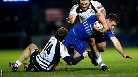 Fergus McFadden is tackled by Giulio Toniolatti and David Ryan at the RDS