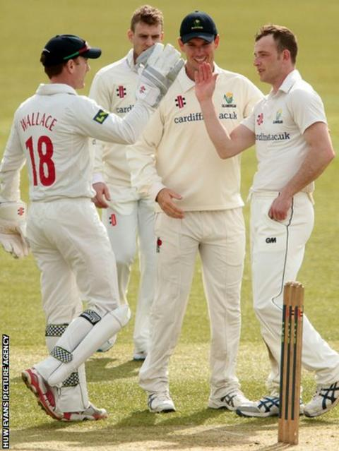 Jim Allenby congratulates Graham Wagg for taking a wicket in their pre-season game against Gloucestershire