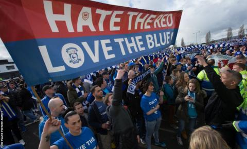 Cardiff City's fans take part in a protest against the club's rebrand outside Cardiff City Stadium before the Premier League game against Liverpool.