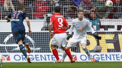 Bastian Schweinsteiger heads home