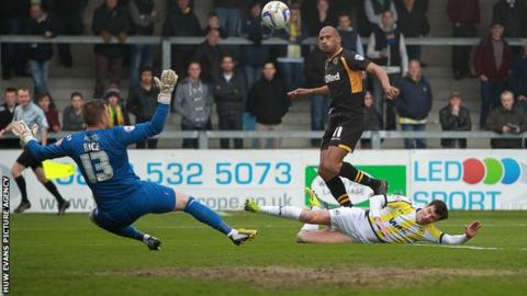 Newport County's Chris Zebroski scores