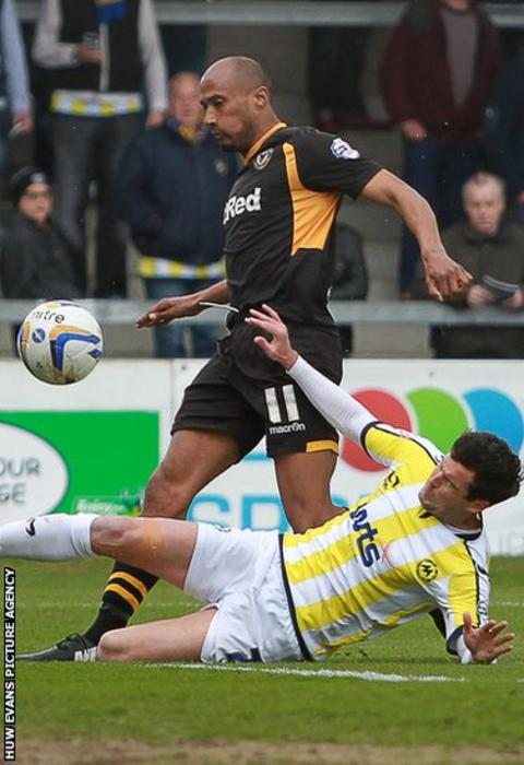 Chris Zebroski scores to give Newport County an early lead away to Torquay United in League Two.