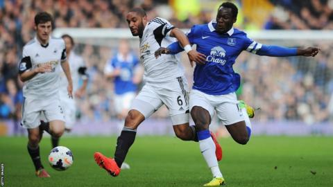 Swansea City captain Ashley Williams battles for the ball with Everton striker Romelu Lukaku during the Premier League match at Goodison Park.