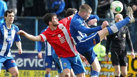 Linfield's Philip Lowry challenges his brother Stephen at the Coleraine Showgrounds