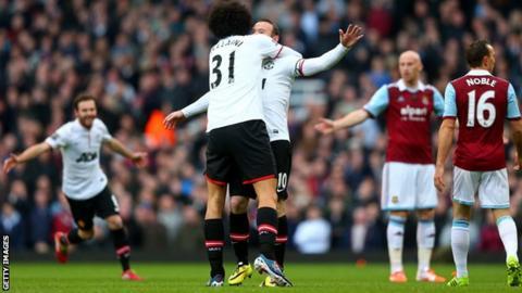 Manchester United striker Wayne Rooney celebrates scoring against West Ham United