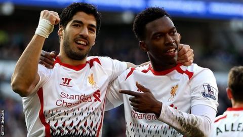 Luis Suarez and Daniel Sturridge celebrate at Cardiff