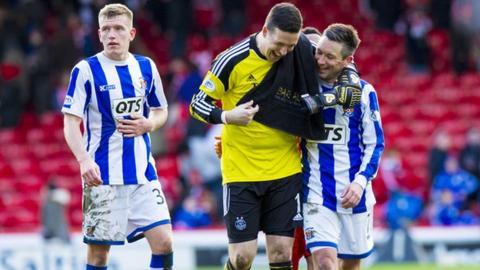 Kilmarnock's Barry Nicholson jokes with Aberdeen's Jamie Langfield