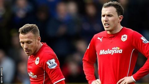 Craig Bellamy is among the dejected Cardiff players against Liverpool