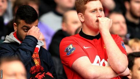Manchester United fans look dejected