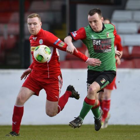 Cliftonville's Chris Curran and Jason Hill of Glentoran go for the ball during the 0-0 draw at the Oval