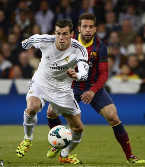 Real Madrid's Gareth Bale battles for the ball with Barcelona defender Jordi Alba during El Clasico at the Bernabeu.