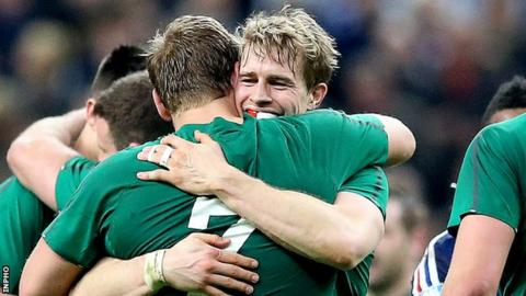 Chris Henry and Andrew Trimble embrace after Ireland clinched the Six Nations title in Paris