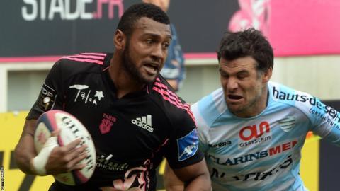 Stade Francais wing Waisea Vuidravuwalu goes past Racing Metro scrum-half Mike Phillips, whose side win their Top 14 French derby 32-22