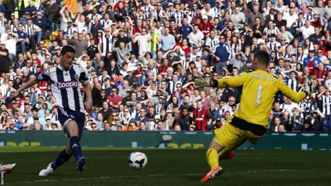 Cardiff keeper David Marshall can do nothing to stop Graham Dorrans making it 2-0 to West Brom at the Hawthorns