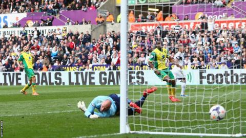 Wayne Routledge puts the result beyond doubt with Swansea's third goal against Norwich