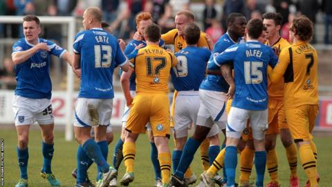 A scuffle breaks out between Newport County and Portsmouth players in the League Two match at Rodney Parade