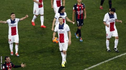 Paris Saint-Germain's players react as the referee blow the final whistle during the Ligue 1 football match against Nice