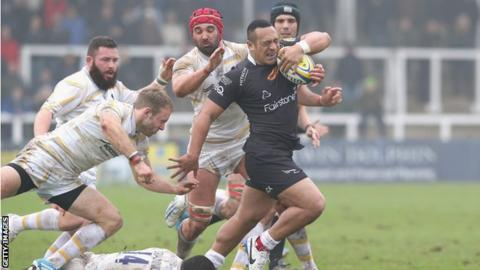 Newcastle Falcons centre Sinoti Sinoti holds off several Worcester Warriors players