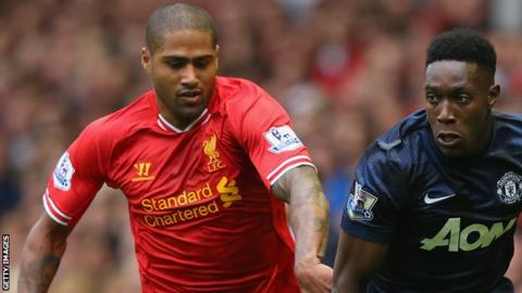 Liverpool's Glen Johnson battles with Danny Welbeck of Manchester United