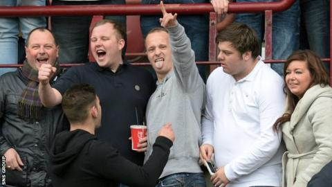 Leigh Griffiths (centre) was among the Hibs supporters at Tynecastle on Sunday