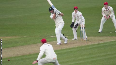 Chris Cooke on-drives for Glamorgan against Cardiff MCCU