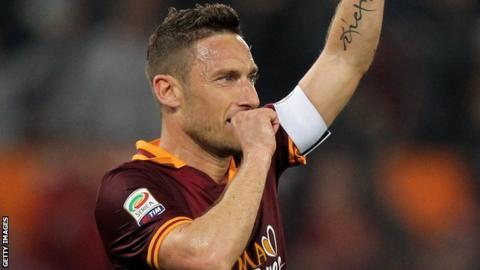 Francesco Totti celebrates his goal against Parma