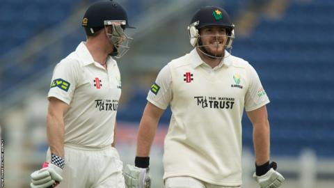 Mark Wallace and Will Bragg leave the field after Glamorgan declare their second innings against Cardiff MCCU in a game which ended in a draw because of rain.