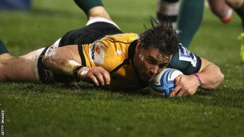 Ben Foden slides in a try for Northampton Saints against Sale Sharks