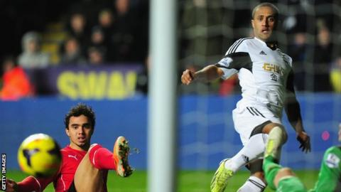Wayne Routledge scores against Cardiff City