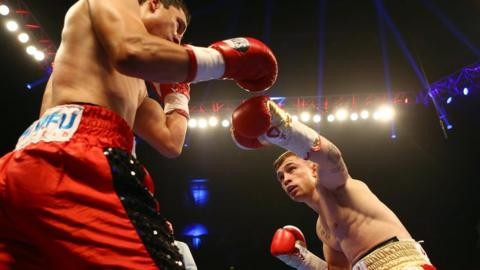 Mexican Cazares is quickly on the defensive as Frampton looks to land another punch