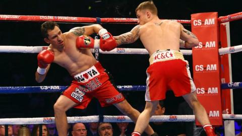 The 36-year-old Cazares reels from a body shot as Frampton chases a quick victory in Belfast