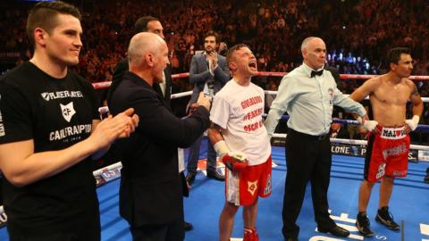 Frampton's trainer Shane McGuigan and manager Barry McGuigan join the celebrations as the super-bantamweight lets his emotions show after the impressive second-round victory