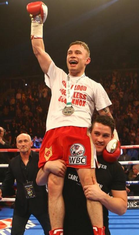 Frampton gets a helping hand from trainer Shane McGuigan to salute his army of delighted fans at the Odyssey
