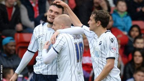 Millwall's Scott Malone (left) is congratulated by team-mates after his goal at Nottingham Forest