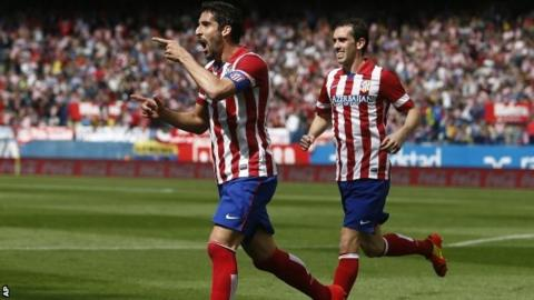 Atletico Madrid's Raul Garcia (left)