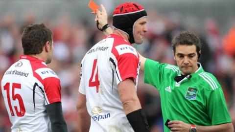 Jared Payne (left) starts his walk to the touchline after being shown a red card by French referee Jerome Garces