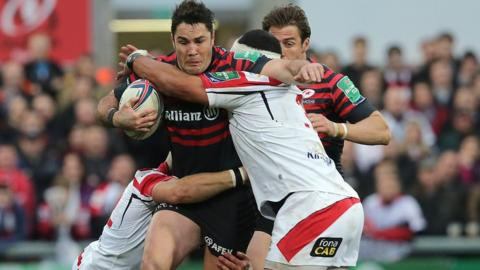 Ulster pair Luke Marshall and John Afoa tackle Brad Barritt as Saracens hold on for a 17-15 victory and a place in the Heineken Cup semi-finals