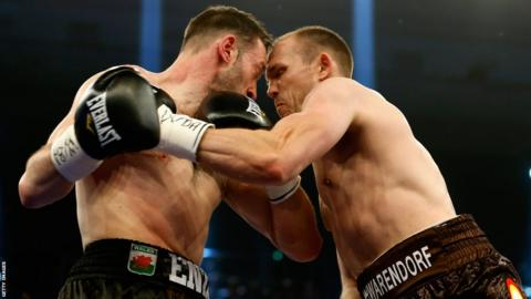 Enzo Maccarinelli and Jurgen Brahmer clash heads in the first round of their WBA light-heavyweight title fight in Rostock, Germany