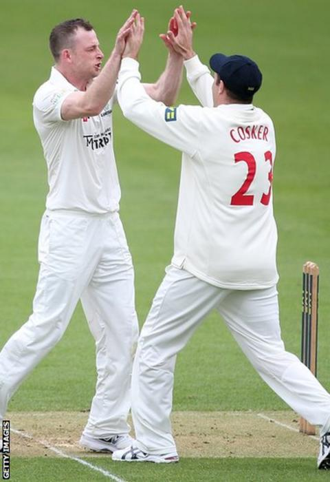 Graeme Wagg is congratulated by Dean Cosker after taking the wicket of Surrey's Graeme Smith during the first innings of Glamorgan's opening County Championship game of the season.