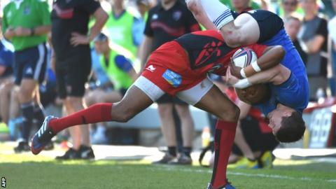 Toulon full-back Delon Armitage is tackled illegally by Brian O'Driscoll