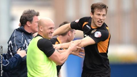Max Porter celebrates his goal against Chesterfield with his team's substitutes