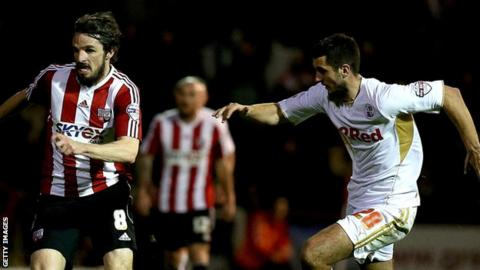 Brentford's Jonathan Douglas and Crawley Town's Gary Dicker (right)