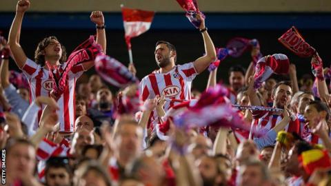 Atletico Madrid fans at the Vicente Calderon stadium celebrating their win over Barcelona in the Champions League