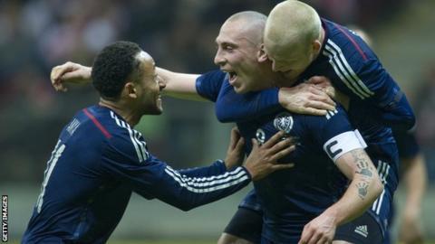 Scotland captain Scott Brown celebrates his winner against Poland