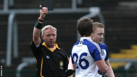 Referee Brendan Rice hands out a black card to Monaghan's Dessie Mone in the McKenna Cup