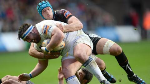Justin Tipuric and Tom Habberfield tackle Martin Moore
