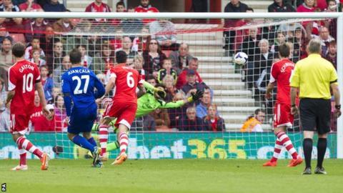 Cardiff defender Juan Cala watches on as his shot beats Southampton keeper Paulo Gazzaniga