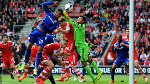 Southampton goalkeeper Paulo Gazzaniga clears off the head of Fraizer Campbell of Cardiff in their Premier League match at St Mary's Stadium