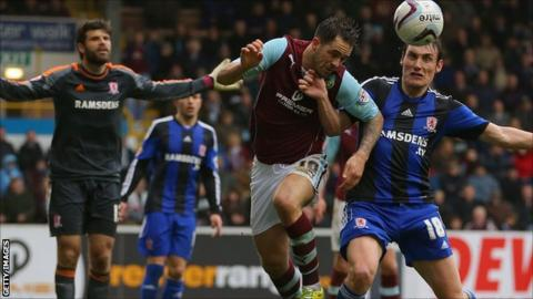 Danny Ings is challenged by Dean Whitehead