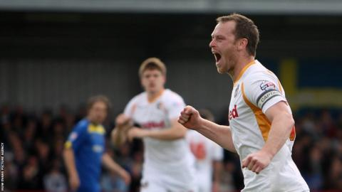 Michael Flynn celebrates after scoring Newport's second goal from the penalty spot but Wimbledon hit back with two goals to earn a point.